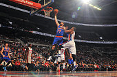 Andrea Bargnani of the New York Knicks goes up for a dunk against the Detroit Pistons on February 27 2015 at The Palace of Auburn Hills in Auburn...