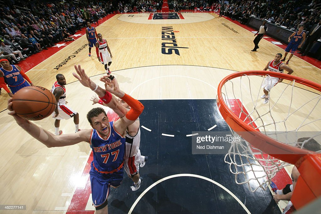 <a gi-track='captionPersonalityLinkClicked' href=/galleries/search?phrase=Andrea+Bargnani&family=editorial&specificpeople=533014 ng-click='$event.stopPropagation()'>Andrea Bargnani</a> #77 of the New York Knicks goes up for the layup against the Washington Wizards during the game at the Verizon Center on November 23, 2013 in Washington, DC.