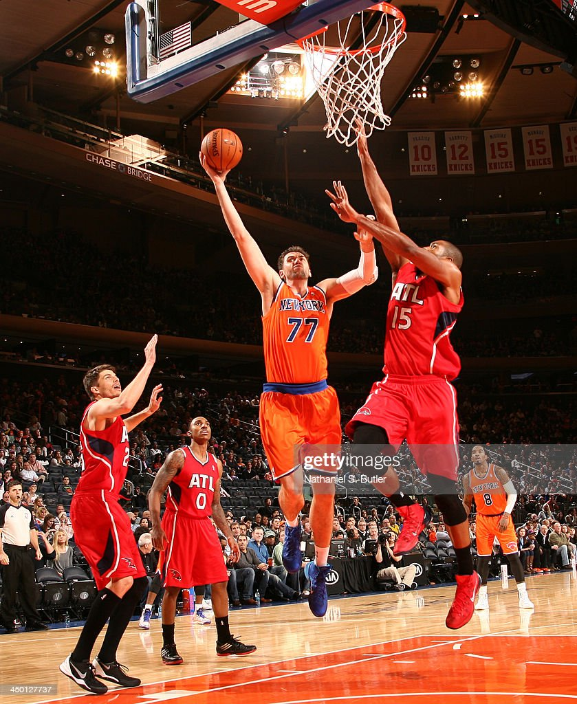 Andrea Bargnani #77 of the NEw York Knicks goes up to shoot against Al Horford #15 of the Atlanta Hawks during a game at Madison Square Garden in New York City on November 16, 2013.