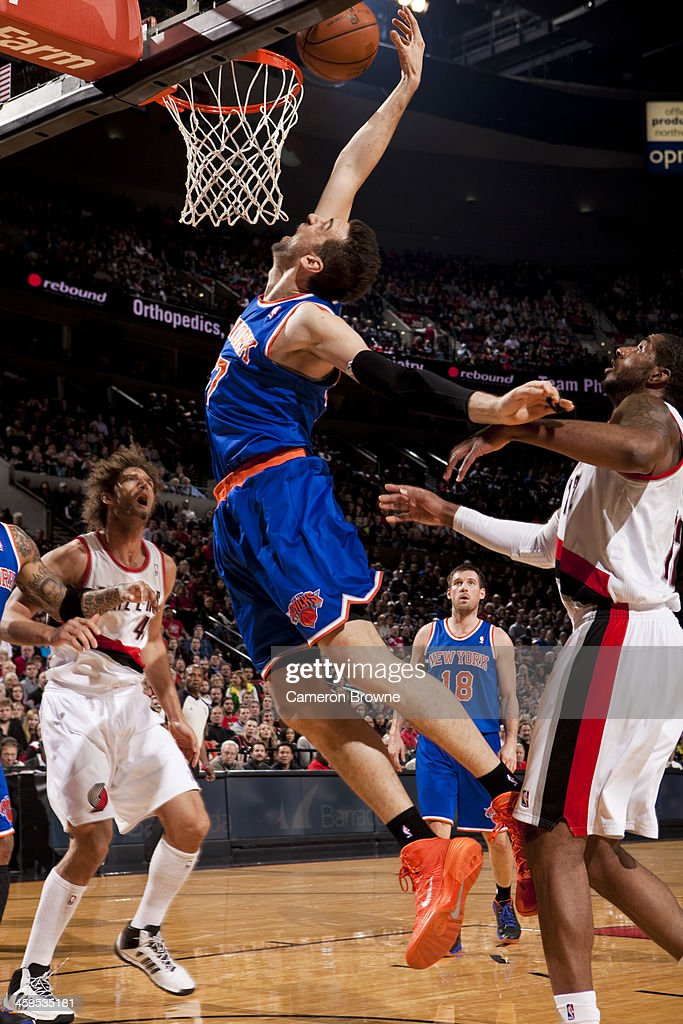 <a gi-track='captionPersonalityLinkClicked' href=/galleries/search?phrase=Andrea+Bargnani&family=editorial&specificpeople=533014 ng-click='$event.stopPropagation()'>Andrea Bargnani</a> #77 of the New York Knicks grabs a rebound against the Portland Trail Blazers on November 25, 2013 at the Moda Center Arena in Portland, Oregon.