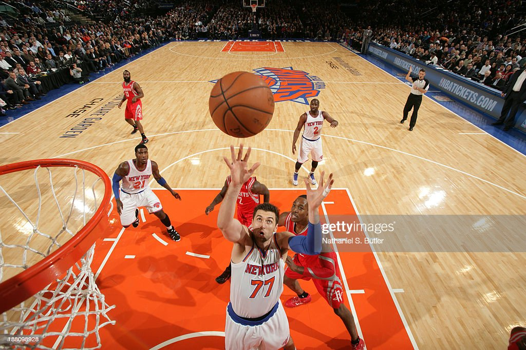<a gi-track='captionPersonalityLinkClicked' href=/galleries/search?phrase=Andrea+Bargnani&family=editorial&specificpeople=533014 ng-click='$event.stopPropagation()'>Andrea Bargnani</a> #77 of the New York Knicks grabs the rebound against the Houston Rockets at Madison Square Garden in New York City on November 14, 2013.