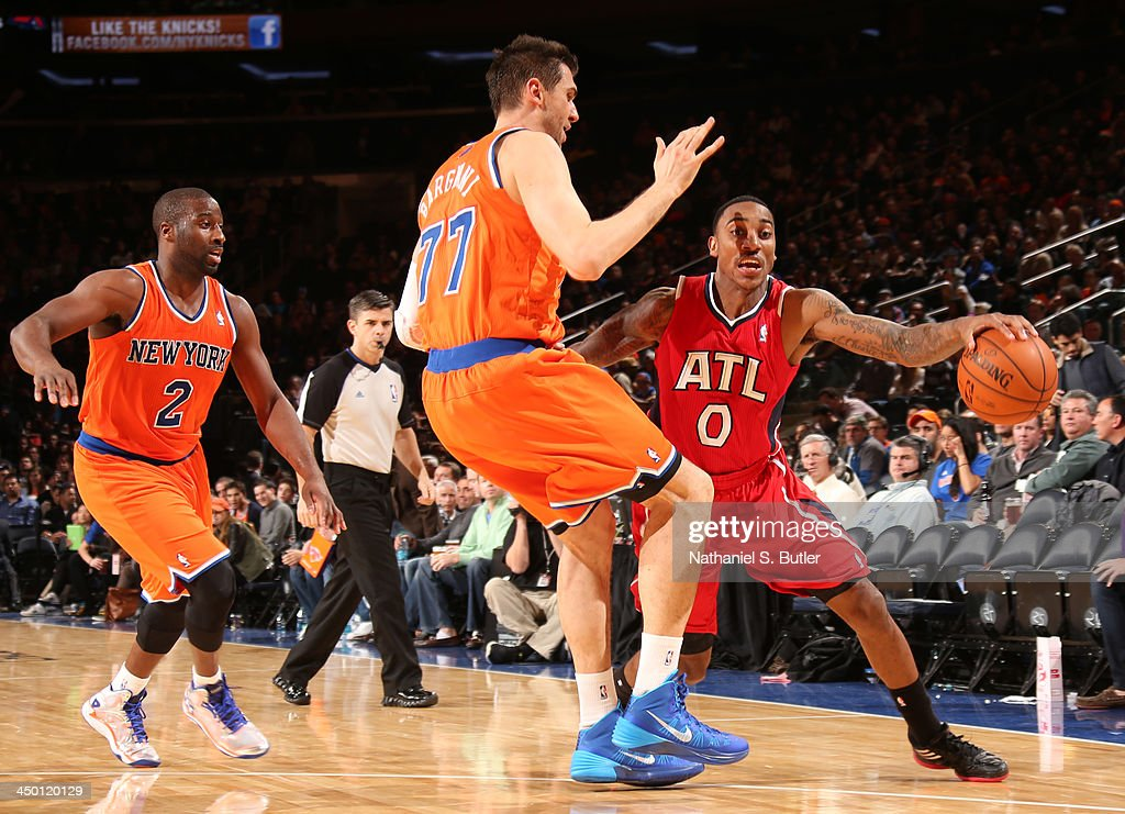 Andrea Bargnani #77 of the New York Knicks guards Jeff Teague #0 of the Atlanta Hawks during a game at Madison Square Garden in New York City on November 16, 2013.