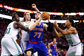 Andrea Bargnani of the New York Knicks is surrounded by members of the Boston Celtics underneath the basket in the second half during the game at TD...