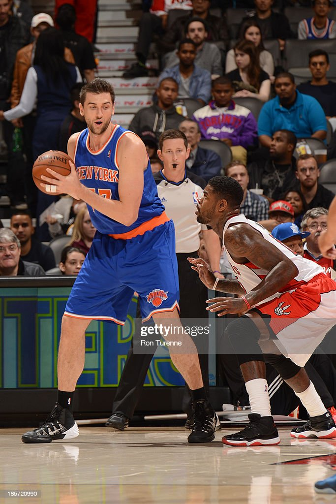 <a gi-track='captionPersonalityLinkClicked' href=/galleries/search?phrase=Andrea+Bargnani&family=editorial&specificpeople=533014 ng-click='$event.stopPropagation()'>Andrea Bargnani</a> #77 of the New York Knicks looks to drive against <a gi-track='captionPersonalityLinkClicked' href=/galleries/search?phrase=Amir+Johnson&family=editorial&specificpeople=556786 ng-click='$event.stopPropagation()'>Amir Johnson</a> #15 of the Toronto Raptors during the game on October 11, 2013 at the Air Canada Centre in Toronto, Ontario, Canada.