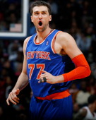 Andrea Bargnani of the New York Knicks reacts after a basket against the Atlanta Hawks at Philips Arena on November 13 2013 in Atlanta Georgia NOTE...