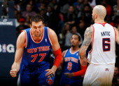 Andrea Bargnani of the New York Knicks reacts after hitting a threepoint basket against Pero Antic of the Atlanta Hawks at Philips Arena on November...