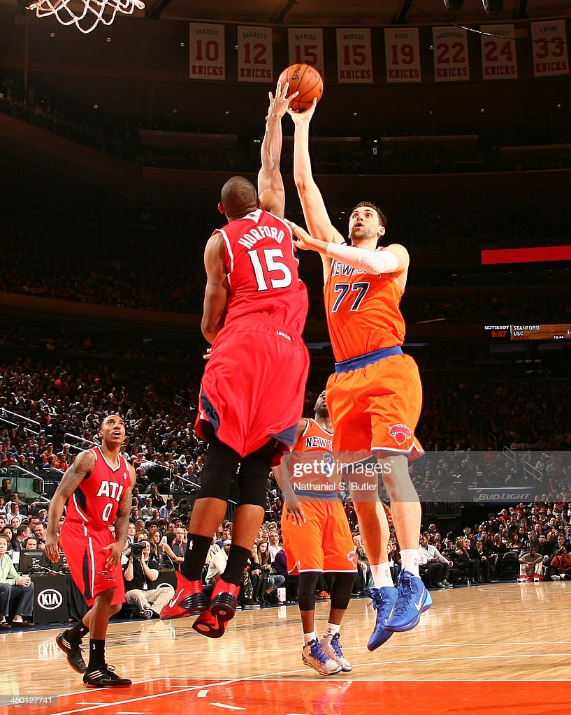 Andrea Bargnani #77 of the New York Knicks shoots against Al Horford #15 of the Atlanta Hawks during a game at Madison Square Garden in New York City on November 16, 2013.
