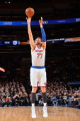 Andrea Bargnani of the New York Knicks shoots against the Philadelphia 76ers on January 22 2014 at Madison Square Garden in New York City New York...