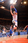 Andrea Bargnani of the New York Knicks shoots against the Philadelphia 76ers during the game on January 22 2014 at Madison Square Garden in New York...