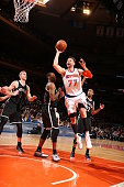 Andrea Bargnani of the New York Knicks shoots against the Brooklyn Nets on April 1 2015 at Madison Square Garden in New York City NOTE TO USER User...