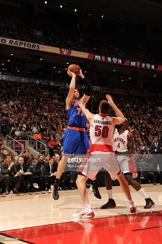 <a gi-track='captionPersonalityLinkClicked' href=/galleries/search?phrase=Andrea+Bargnani&family=editorial&specificpeople=533014 ng-click='$event.stopPropagation()'>Andrea Bargnani</a> #77 of the New York Knicks shoots the ball against the Toronto Raptors during the game on October 21, 2013 at the Air Canada Centre in Toronto, Ontario, Canada.