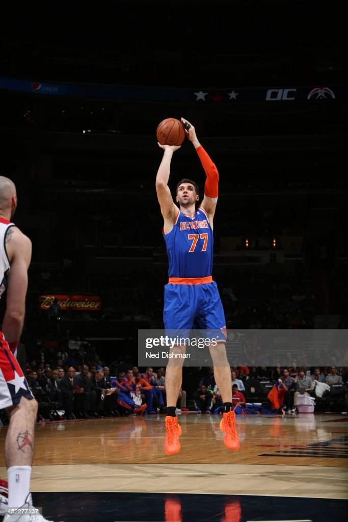 <a gi-track='captionPersonalityLinkClicked' href=/galleries/search?phrase=Andrea+Bargnani&family=editorial&specificpeople=533014 ng-click='$event.stopPropagation()'>Andrea Bargnani</a> #77 of the New York Knicks shoots the ball at the top of the key against the Washington Wizards during the game at the Verizon Center on November 23, 2013 in Washington, DC.