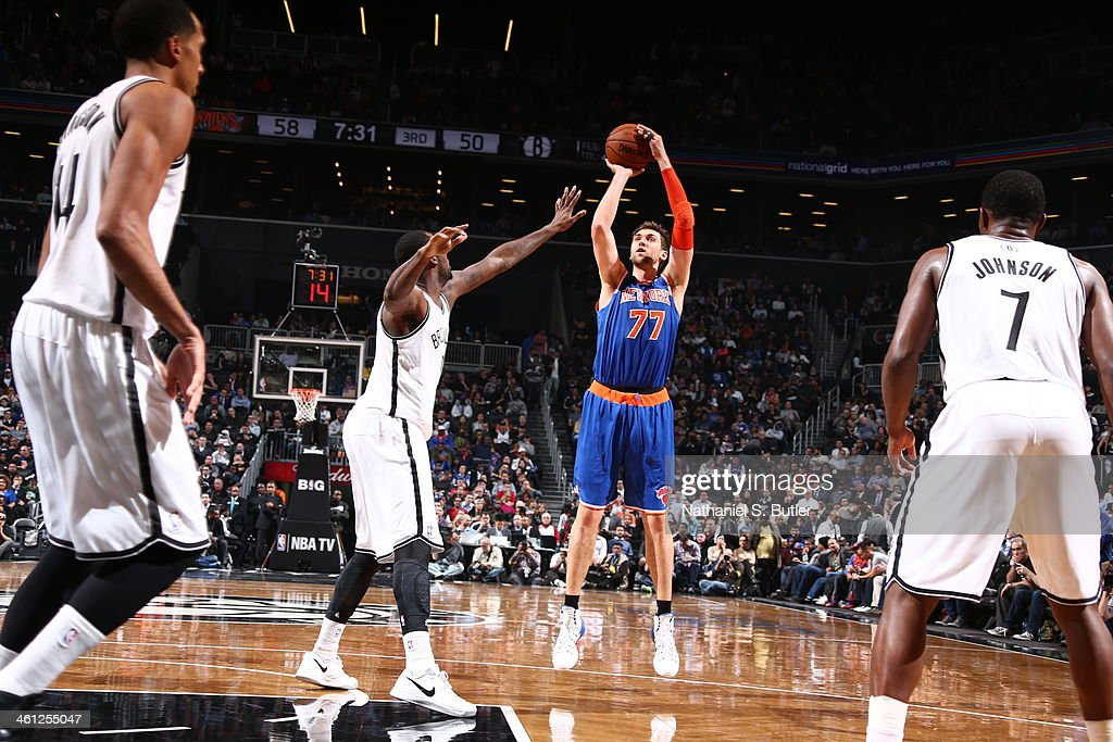<a gi-track='captionPersonalityLinkClicked' href=/galleries/search?phrase=Andrea+Bargnani&family=editorial&specificpeople=533014 ng-click='$event.stopPropagation()'>Andrea Bargnani</a> #77 of the New York Knicks taking a shot during a game against the Brooklyn Nets during a game at Barclays Center on December 5, 2013 in the Brooklyn borough of New York City.