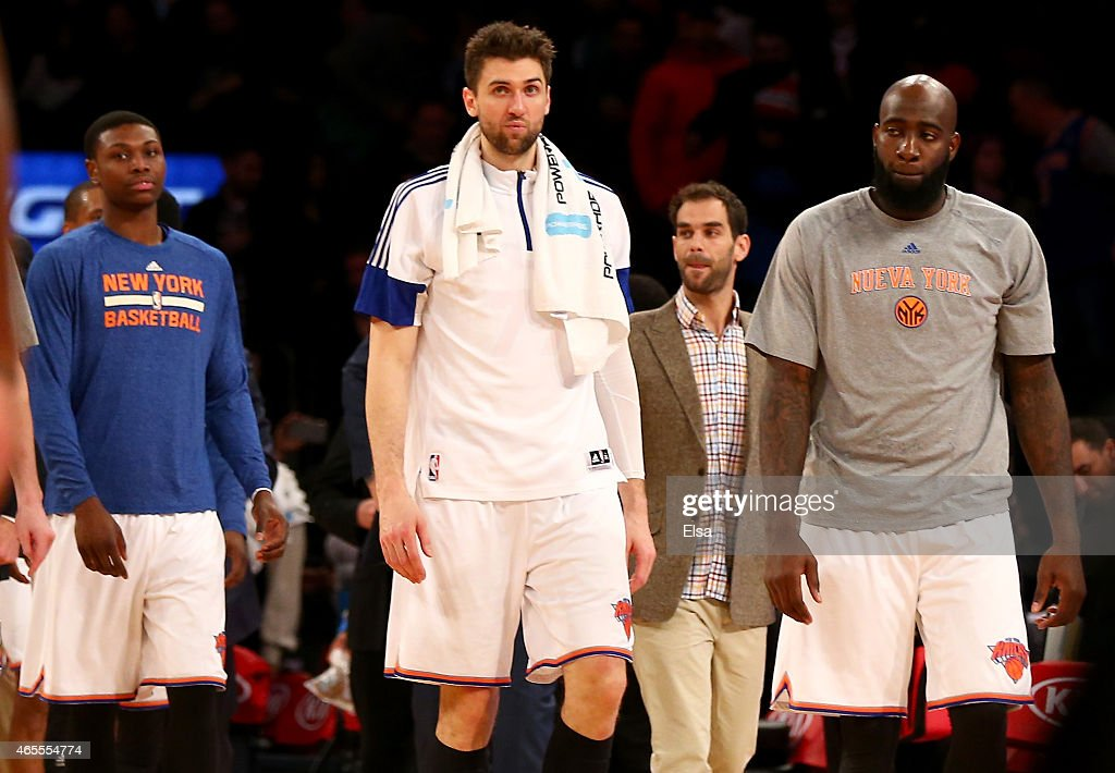 Andrea Bargnani #77 of the New York Knicks walks off the court with teammates Cleanthony Early #17,Jose Calderon and Quincy Acy #4 after the game against the Indiana Pacers at Madison Square Garden on March 7, 2015 in New York City.The Indiana Pacers defeated the New York Knicks 92-86.NOTE