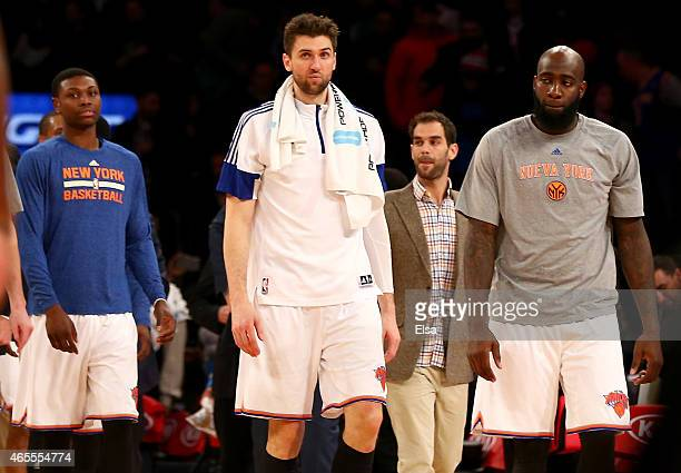 Andrea Bargnani of the New York Knicks walks off the court with teammates Cleanthony EarlyJose Calderon and Quincy Acy after the game against the...