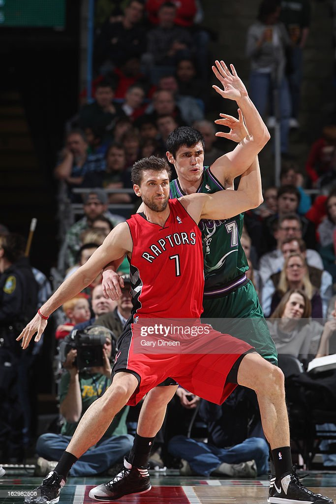Andrea Bargnani #7 of the Toronto Raptors and Ersan Ilyasova #7 of the Milwaukee Bucks battle for positioning during the game on March 2, 2013 at the BMO Harris Bradley Center in Milwaukee, Wisconsin.