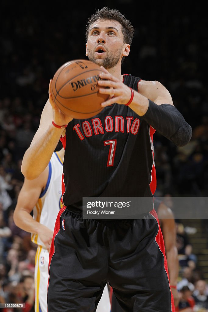 Andrea Bargnani #7 of the Toronto Raptors attempts a free throw against the Golden State Warriors on March 4, 2013 at Oracle Arena in Oakland, California.