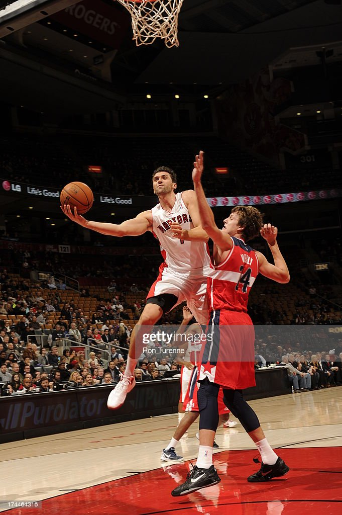 <a gi-track='captionPersonalityLinkClicked' href=/galleries/search?phrase=Andrea+Bargnani&family=editorial&specificpeople=533014 ng-click='$event.stopPropagation()'>Andrea Bargnani</a> #7 of the Toronto Raptors attempts a layup against <a gi-track='captionPersonalityLinkClicked' href=/galleries/search?phrase=Jan+Vesely&family=editorial&specificpeople=5620499 ng-click='$event.stopPropagation()'>Jan Vesely</a> #24 of the Washington Wizards during a pre-season game on October 17, 2012 at the Air Canada Centre in Toronto, Ontario, Canada.