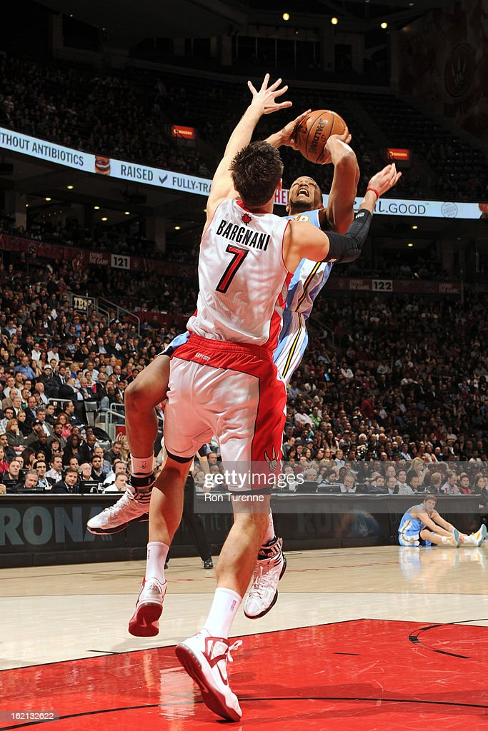 <a gi-track='captionPersonalityLinkClicked' href=/galleries/search?phrase=Andrea+Bargnani&family=editorial&specificpeople=533014 ng-click='$event.stopPropagation()'>Andrea Bargnani</a> #7 of the Toronto Raptors defends a shot against the Denver Nuggets on February 12, 2013 at the Air Canada Centre in Toronto, Ontario, Canada.