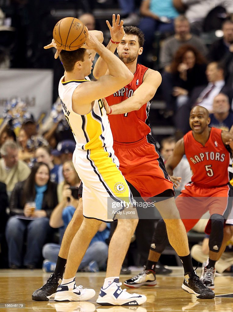 <a gi-track='captionPersonalityLinkClicked' href=/galleries/search?phrase=Andrea+Bargnani&family=editorial&specificpeople=533014 ng-click='$event.stopPropagation()'>Andrea Bargnani</a> #7 of the Toronto Raptors defends <a gi-track='captionPersonalityLinkClicked' href=/galleries/search?phrase=Tyler+Hansbrough&family=editorial&specificpeople=642794 ng-click='$event.stopPropagation()'>Tyler Hansbrough</a> #50 of the Indiana Pacers during the NBA game at Bankers Life Fieldhouse on November 13, 2012 in Indianapolis, Indiana.