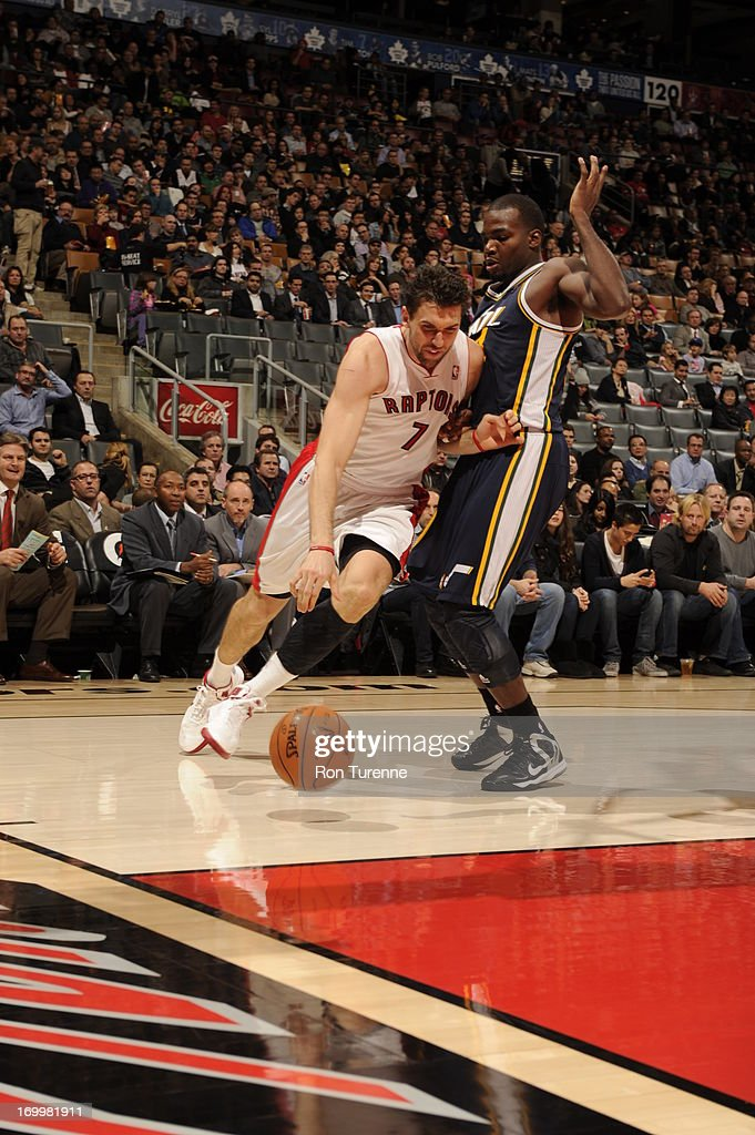 <a gi-track='captionPersonalityLinkClicked' href=/galleries/search?phrase=Andrea+Bargnani&family=editorial&specificpeople=533014 ng-click='$event.stopPropagation()'>Andrea Bargnani</a> #7 of the Toronto Raptors dribbles baseline against the Utah Jazz during the game on November 12, 2012 at the Air Canada Centre in Toronto, Ontario, Canada.