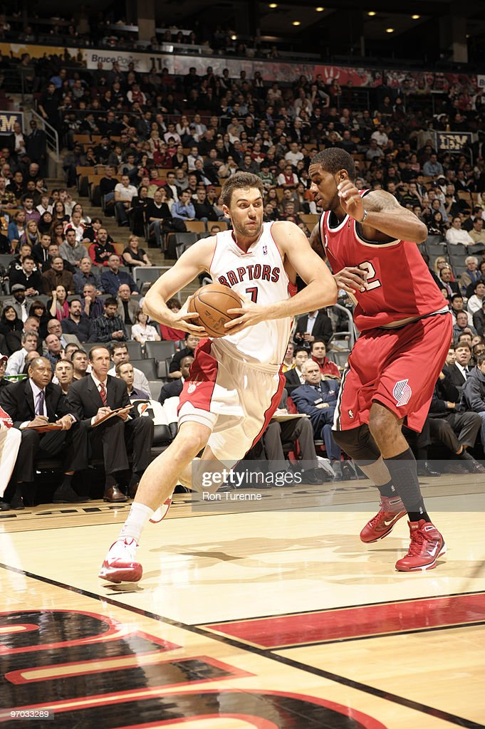 Andrea Bargnani #7 of the Toronto Raptors drives baseline past LaMarcus Aldridge #12 of the Portland Trail Blazers during a game on on February 24, 2010 at the Air Canada Centre in Toronto, Ontario, Canada.
