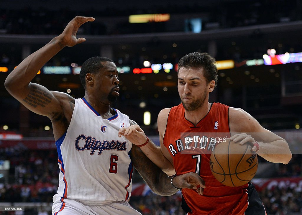 Andrea Bargnani #7 of the Toronto Raptors drives on DeAndre Jordan #6 of the Los Angeles Clippers during a 102-83 Clipper win at Staples Center on December 9, 2012 in Los Angeles, California.