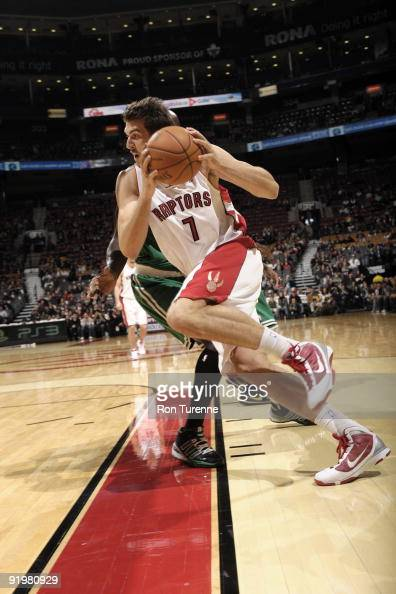 Andrea Bargnani of the Toronto Raptors drives strong along the basline during a game against the Boston Celtics on October 18 2009 at the Air Canada...