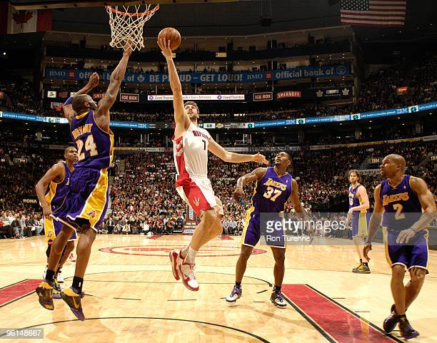 Andrea Bargnani of the Toronto Raptors drives the lane and tries the fingerroll over a jumping Kobe Bryant of the Los Angeles Lakers during a game on...