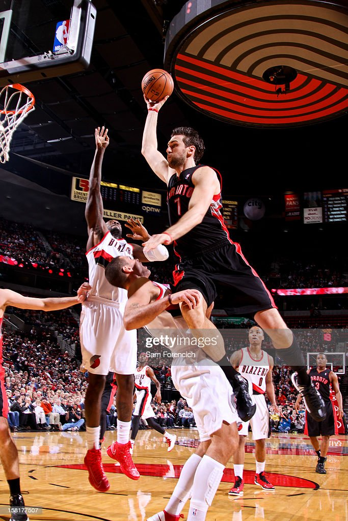 Andrea Bargnani #7 of the Toronto Raptors drives to the basket against Sasha Pavlovic #3 of the Portland Trail Blazers on December 10, 2012 at the Rose Garden Arena in Portland, Oregon.