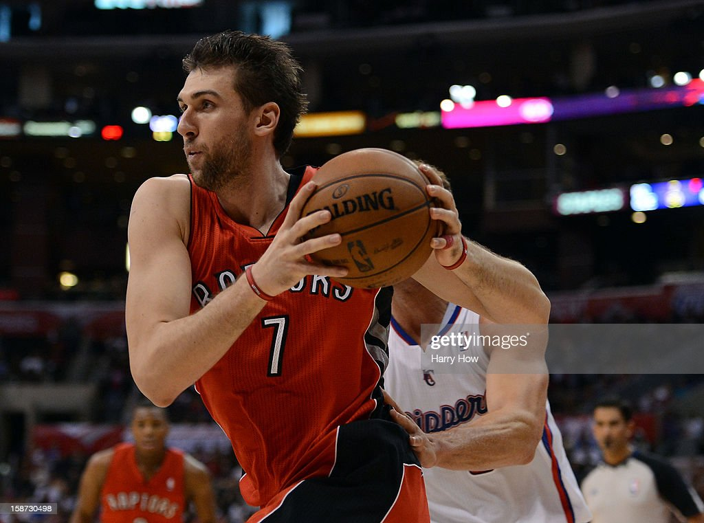 Andrea Bargnani #7 of the Toronto Raptors drives to the basket during a 102-83 Los Angeles Clipper win at Staples Center on December 9, 2012 in Los Angeles, California.
