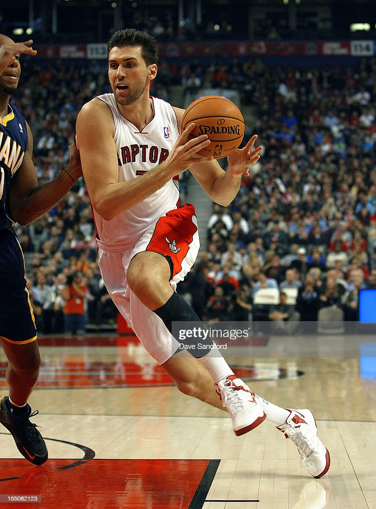 <a gi-track='captionPersonalityLinkClicked' href=/galleries/search?phrase=Andrea+Bargnani&family=editorial&specificpeople=533014 ng-click='$event.stopPropagation()'>Andrea Bargnani</a> #7 of the Toronto Raptors drives to the net against the Indiana Pacers on October 31, 2012 at the Air Canada Centre in Toronto, Canada.