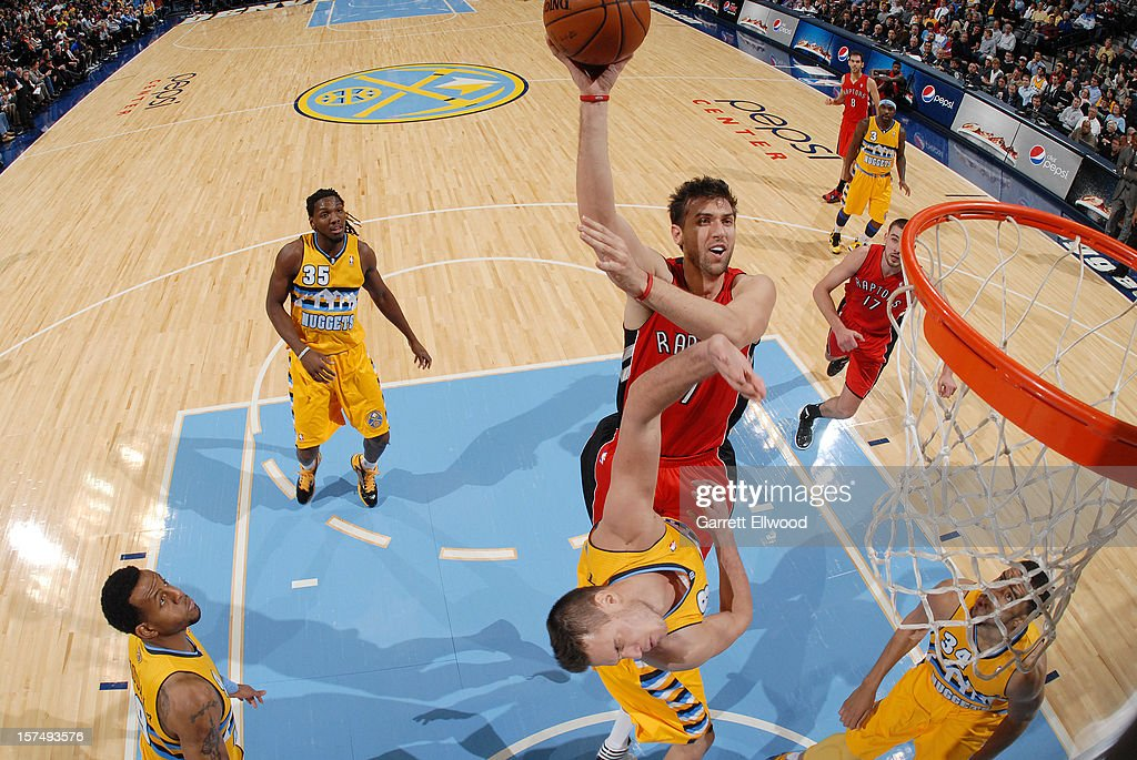 Andrea Bargnani #7 of The Toronto Raptors goes in for the layup versus the Denver Nuggets on December 3, 2012 at the Pepsi Center in Denver, Colorado.
