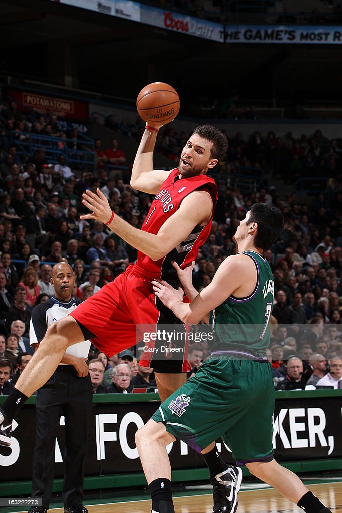 Andrea Bargnani #7 of the Toronto Raptors grabs a rebound against the Milwaukee Bucks on March 2, 2013 at the BMO Harris Bradley Center in Milwaukee, Wisconsin.