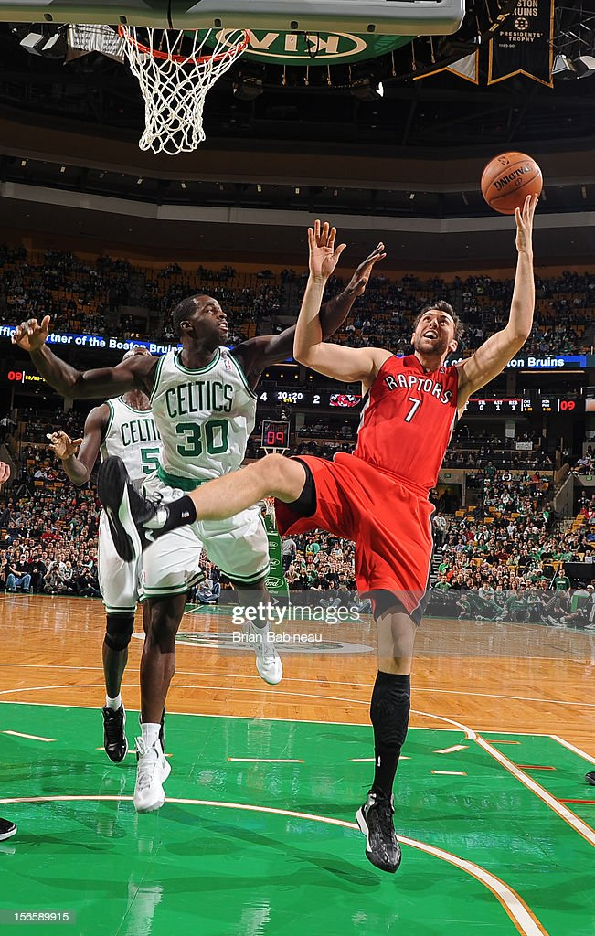 Andrea Bargnani #7 of the Toronto Raptors grabs a rebound over Brandon Bass #30 of the Boston Celtics on November 17, 2012 at the TD Garden in Boston, Massachusetts.