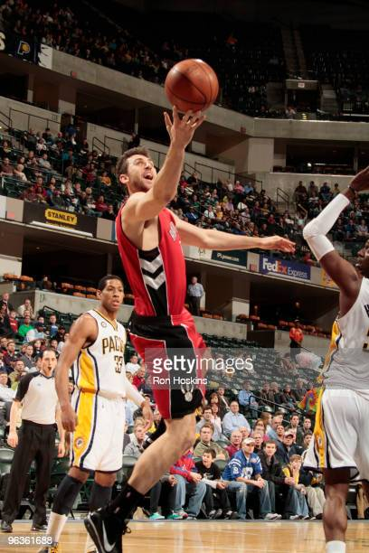 Andrea Bargnani of the Toronto Raptors lays the ball up on Danny Granger of the Indiana Pacers at Conseco Fieldhouse on February 2 2010 in...