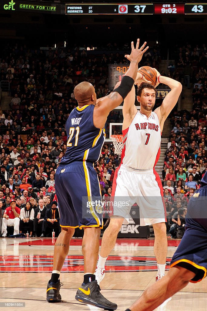 Andrea Bargnani #7 of the Toronto Raptors looks to pass the ball against David West #21 of the Indiana Pacers on March 1, 2013 at the Air Canada Centre in Toronto, Ontario, Canada.