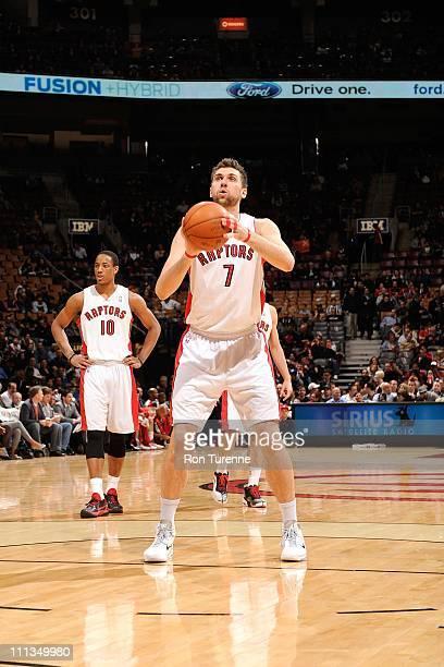 Andrea Bargnani of the Toronto Raptors shoots a free throw against the Milwaukee Bucks on March 30 2011 at the Air Canada Centre in Toronto Ontario...