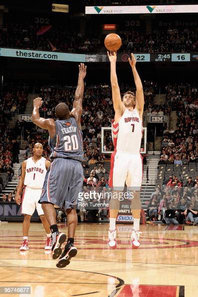 Andrea Bargnani of the Toronto Raptors shoots a jumper against Raymond Felton of the Charlotte Bobcats during the game on December 30 2009 at Air...