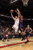 Andrea Bargnani of the Toronto Raptors shoots against Al Horford of the Atlanta Hawks during a game on January 12 2011 at the Air Canada Centre in...
