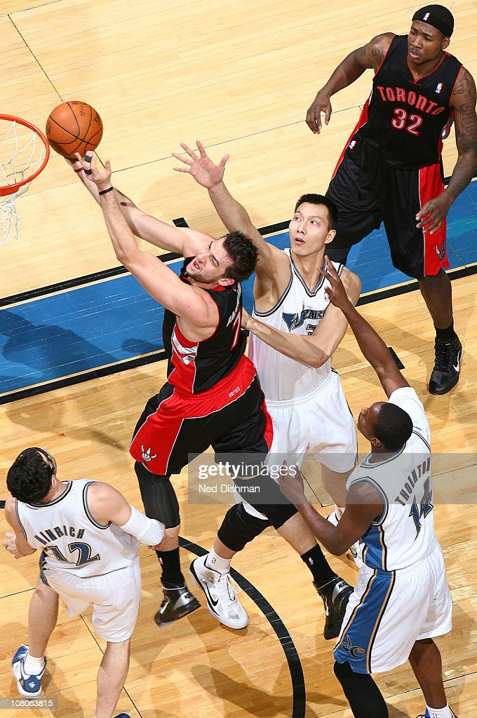 <a gi-track='captionPersonalityLinkClicked' href=/galleries/search?phrase=Andrea+Bargnani&family=editorial&specificpeople=533014 ng-click='$event.stopPropagation()'>Andrea Bargnani</a> #7 of the Toronto Raptors shoots against <a gi-track='captionPersonalityLinkClicked' href=/galleries/search?phrase=Kirk+Hinrich&family=editorial&specificpeople=201629 ng-click='$event.stopPropagation()'>Kirk Hinrich</a> #12 and <a gi-track='captionPersonalityLinkClicked' href=/galleries/search?phrase=Yi+Jianlian&family=editorial&specificpeople=646125 ng-click='$event.stopPropagation()'>Yi Jianlian</a> #31 of the Washington Wizards at the Verizon Center on January 15, 2011 in Washington, DC.