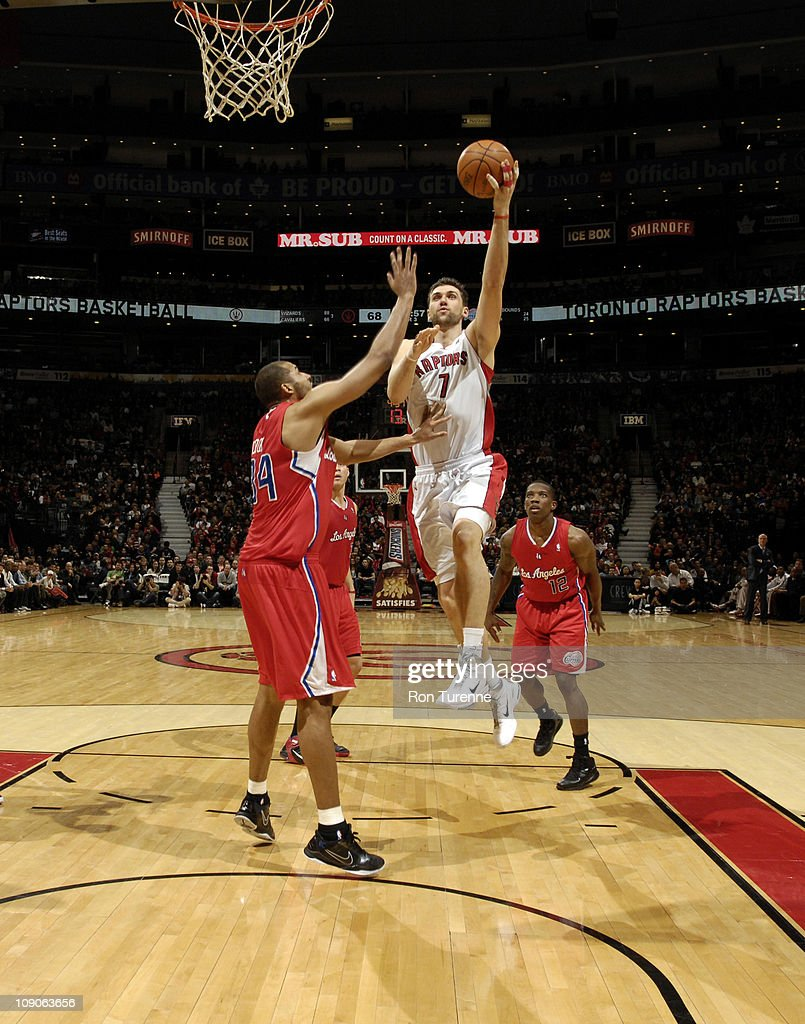 <a gi-track='captionPersonalityLinkClicked' href=/galleries/search?phrase=Andrea+Bargnani&family=editorial&specificpeople=533014 ng-click='$event.stopPropagation()'>Andrea Bargnani</a> #7 of the Toronto Raptors shoots over <a gi-track='captionPersonalityLinkClicked' href=/galleries/search?phrase=Brian+Cook+-+Basketball+Player&family=editorial&specificpeople=202839 ng-click='$event.stopPropagation()'>Brian Cook</a> #34 of the Los Angeles Clippers on February 13, 2011 at the Air Canada Centre in Toronto, Ontario, Canada.