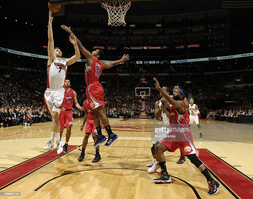 <a gi-track='captionPersonalityLinkClicked' href=/galleries/search?phrase=Andrea+Bargnani&family=editorial&specificpeople=533014 ng-click='$event.stopPropagation()'>Andrea Bargnani</a> #7 of the Toronto Raptors shoots over <a gi-track='captionPersonalityLinkClicked' href=/galleries/search?phrase=Ryan+Gomes&family=editorial&specificpeople=556266 ng-click='$event.stopPropagation()'>Ryan Gomes</a> #15 of the Los Angeles Clippers on February 13, 2011 at the Air Canada Centre in Toronto, Ontario, Canada.