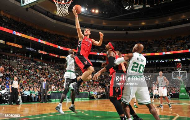 Andrea Bargnani of the Toronto Raptors shoots the ball against the Boston Celtics during the preseason game on December 21 2011 at the TD Garden in...