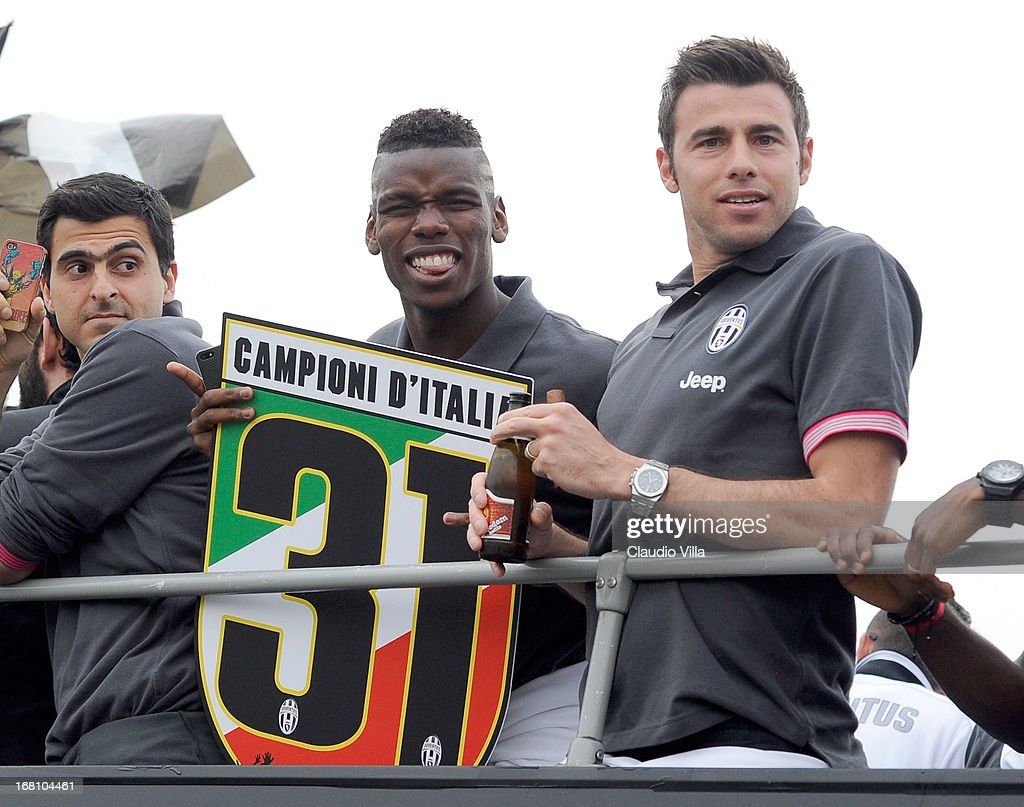 Andrea Barzagli (R) and Paul Pogba of Juventus celebrates at the end of the Serie A match between Juventus and US Citta di Palermo at Juventus Arena on May 5, 2013 in Turin, Italy.