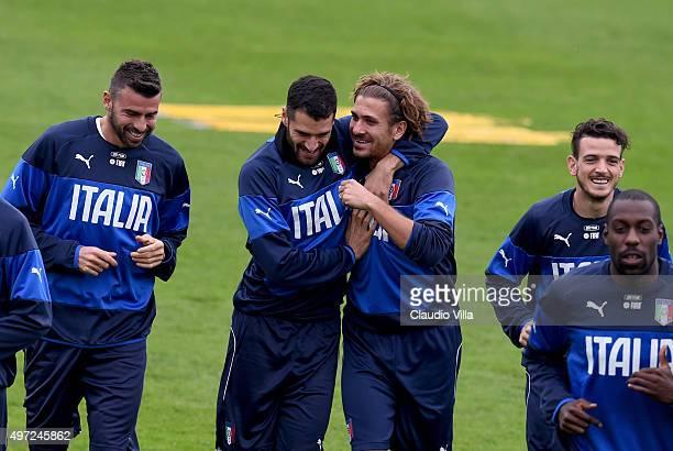 Andrea Barzagli Antonio Candreva Alessio Cerci and Alessandro Florenzi in action the Italy training session at Coverciano on November 15 2015 in...