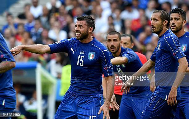 Andrea Barzagli Leonardo Bonucci and Giorgio Chiellini react during the UEFA Euro 2016 Round of 16 match between Italy and Spain at Stade de France...