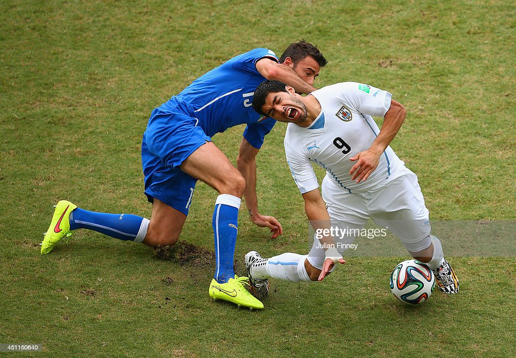 Andrea Barzagli of Italy challenges Luis Suarez of Uruguay during the 2014 FIFA World Cup Brazil Group D match between Italy and Uruguay at Estadio das Dunas on June 24, 2014 in Natal, Brazil.
