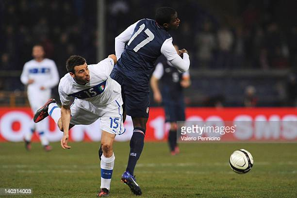Andrea Barzagli of Italy clashes with Edson Buddle of USA during the international friendly match between Italy and USA at Luigi Ferraris Stadium on...
