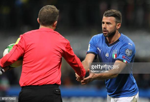 Andrea Barzagli of Italy shakes hands Antonio Mateu Lahoz referee during the FIFA 2018 World Cup Qualifier PlayOff Second Leg between Italy and...
